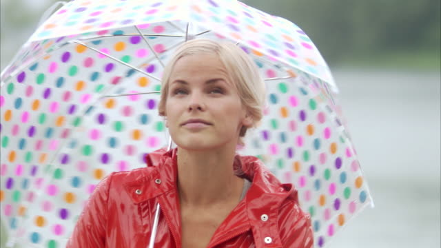 A woman with a spotted umbrella Sweden.