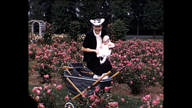 1940 - Woman with Baby in Rose Garden