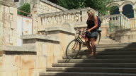 Woman with bike on stairs