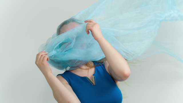 Woman with blue fabric on head