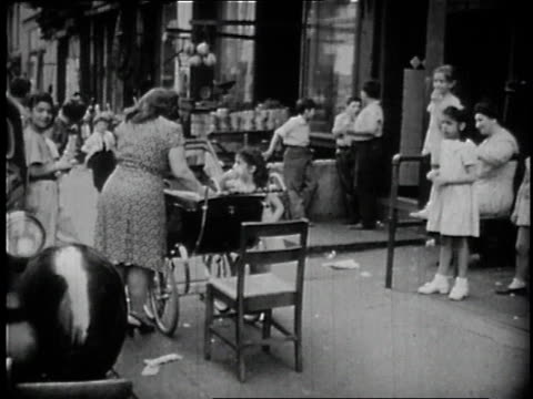 1946 WS Woman with buggy and girls on city street / Lower East Side, New York City, New York, United States