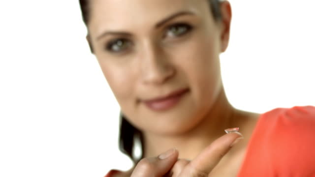 HD: Woman With Contact Lens On Finger