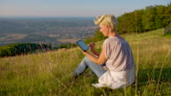 WS DS Woman With Digital Tablet Sitting On Hill