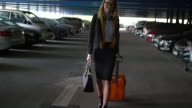Woman with orange suitcase