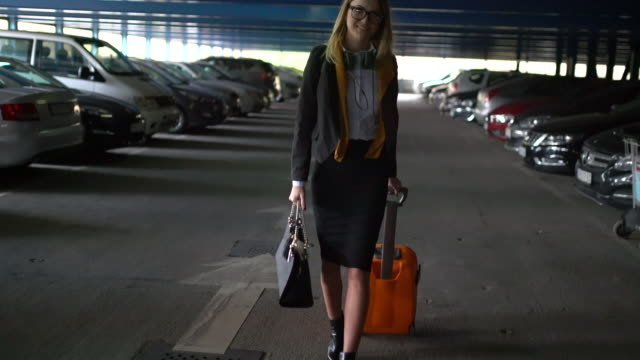 Woman with orange suitcase