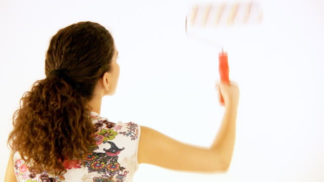 HD: Woman with paint roller