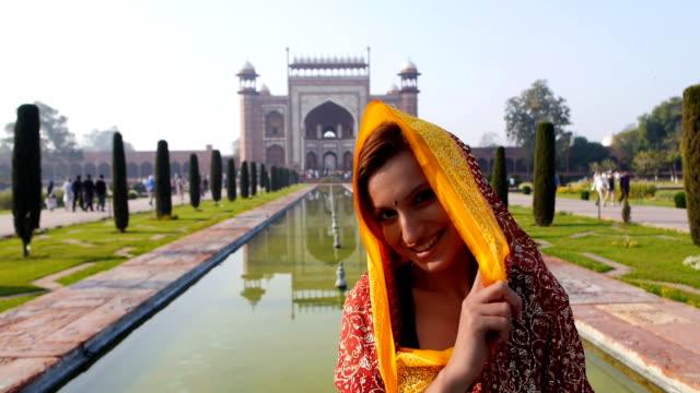 Woman with Taj Mahal entrance at the back