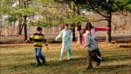 MS, PAN, Woman with three children (12-13, 14-15) playing soccer, Orangeburg, New York, USA