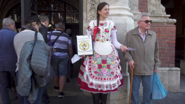 Woman with traditional costume at Budapest Central market door