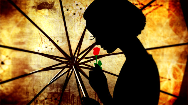 Woman with umbrella and red flower