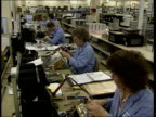 LIB Woman working assembling components in Marconi factory TILT DOWN Workers working in Marconi factory Marconi contro centre TILT LIB Lord Simpson...