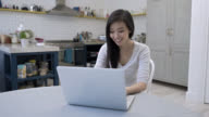 Woman working from home very happy on her laptopBeautiful asian woman working from home very happy on her laptop