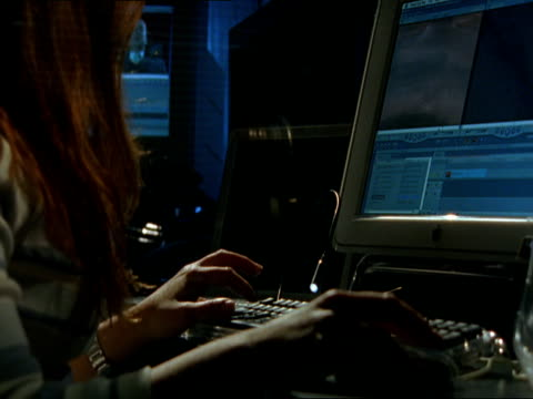 CU, TD, Woman working on computer at night, editing video