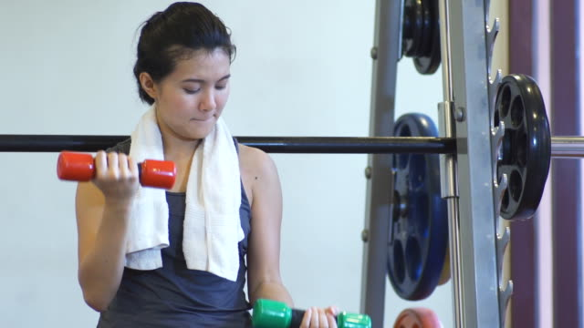 Woman Working With Weights In Gym