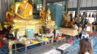 HD: Woman worshiping Buddha