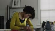 MS PAN Woman writing card in office / Orem, Utah, USA