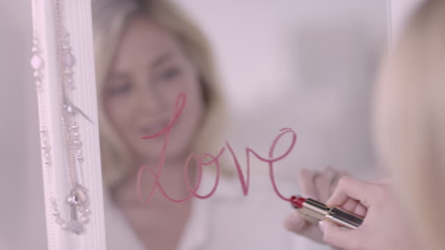 Woman writing with lipstick