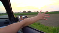 HD SUPER SLOW-MOTION: Woman's Arm Sticking Out Of The Car