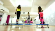 Womans behind,trampoline workout,rear view