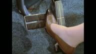 CU Woman's foot pressing car break pedal / United States