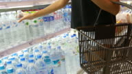 woman's hand fresh water in retail store