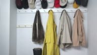 CU Woman's hand hanging jacket on hook in cloakroom, Scarborough, New York, USA