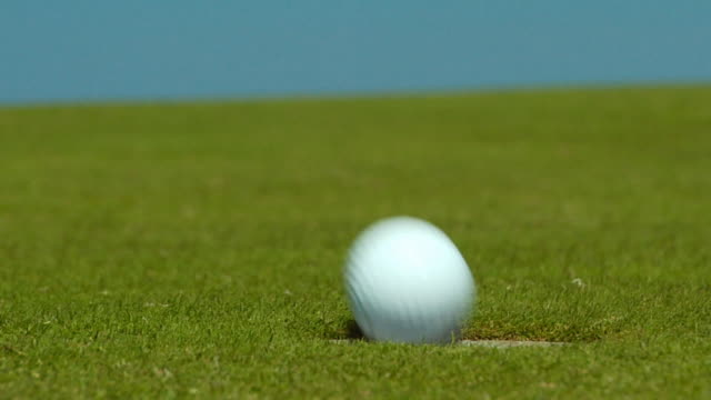 CU, SELECTIVE FOCUS, Woman's hand removing golf ball passing from hole, North Truro, Massachusetts, USA