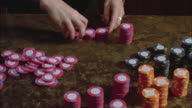 CU Woman's hand stacking betting chips