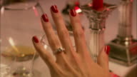 CU, Woman's hand with engagement ring, London, England