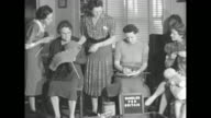 CU womans hands knitting pan to official âBundles for Britain pin on womans dress / VS group of various aged women knit inspect knitting sign on...