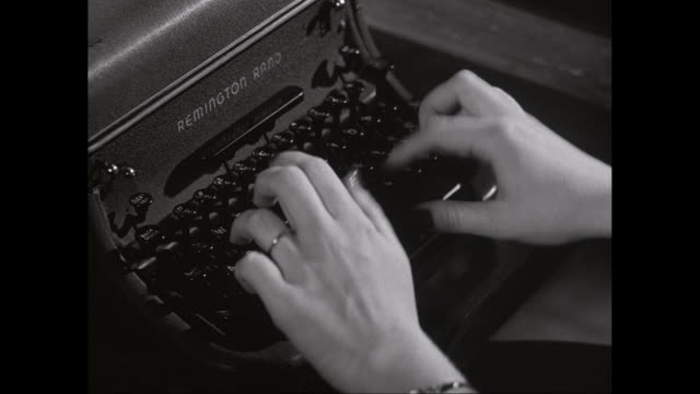 CU HA Woman's hands typing on antique typewriter / United States