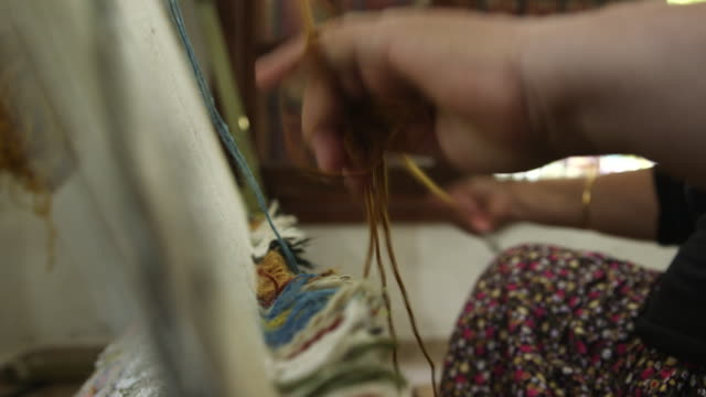 Woman's Hands Working The Loom