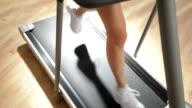 Woman's Legs on Running Treadmill