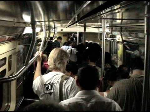 Woman's voice announcing evacuation as people slowly file out of subway car 2003 blackout people evacuating subway car on August 14 2003 in New York...