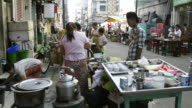MS Women are cooking in food stall at 19th street / Yangon, Yangon Division, Myanmar