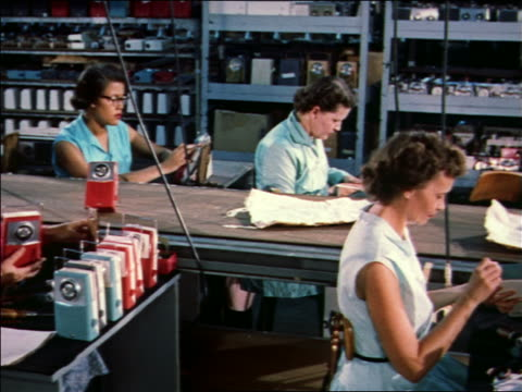 1959 women assembling transistors radios on assembly line