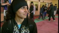 Women boxers train for London 2012 Olympics AFGHANISTAN Kabul Reporter to camera in snow covered Ghazi sports stadium INT Shabnan Rahimi shadow...