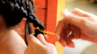 CU/women braid hairstyle in beauty salon
