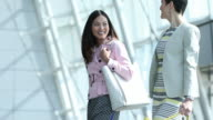 Women Business Travelers in Airport Terminal