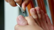 women cutting nail and skin foot