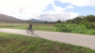 Women cycling on country road