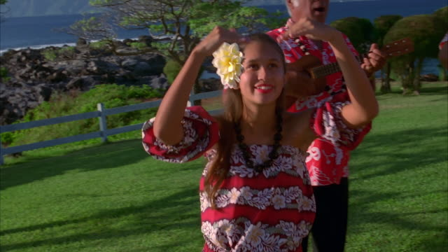 A women dances the hula in Maui. Available in HD.