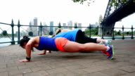 Women Doing Pushups and the Plank by Sydney Harbour