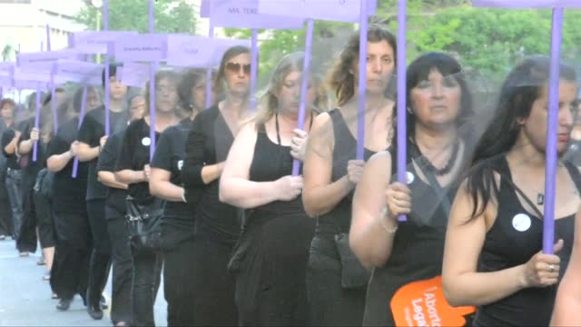 Women dressed in black marched in Montevideo to raise awareness about the dangers of domestic violence a crime that has cost the lives of hundreds in...