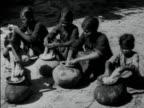 Women dyeing yarn with indigo in pots