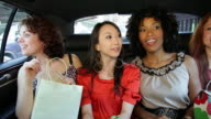 CU Women friends sitting in back of limo after shopping trip / NYC, New York, United States