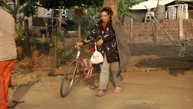 MS ZO Women getting her bicycle and net to going fishing / Mato Grosso do Sul, Brazil