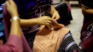 women hand sewing