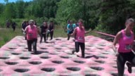 Women have fun time running through time maze