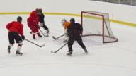 Women ice hockey team playing on practice